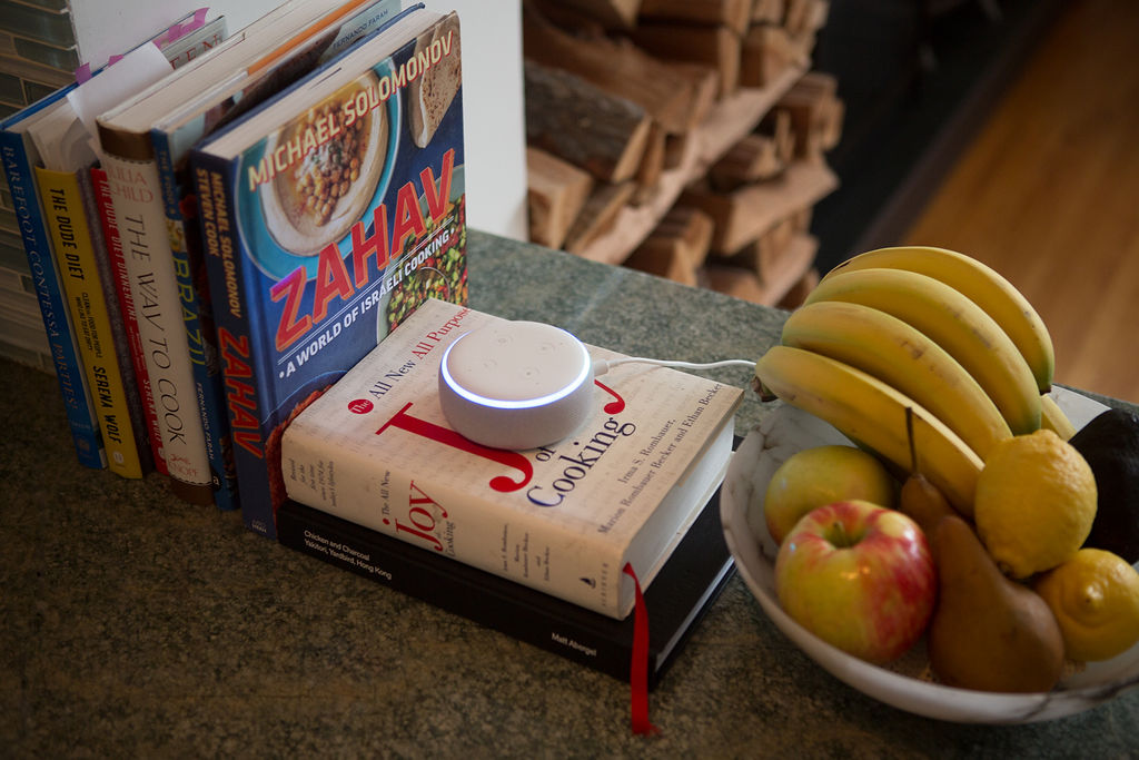 Echo dot on a pile of books
