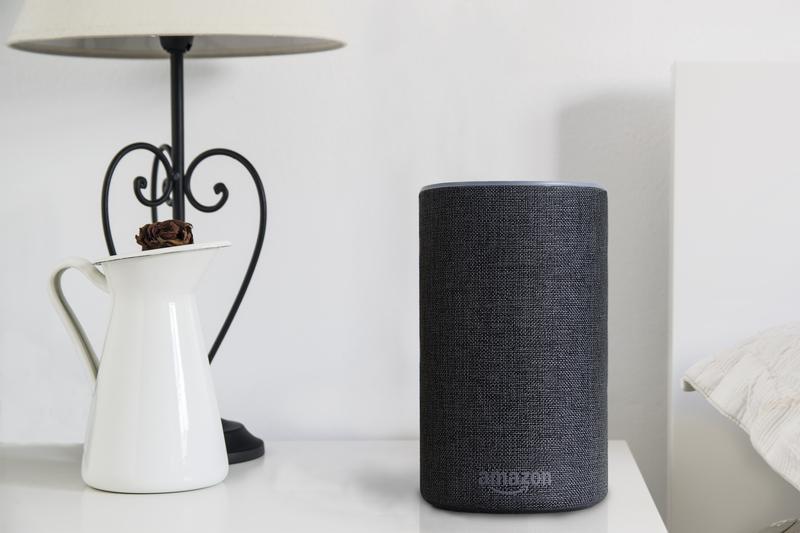Echo speaker on bedside table