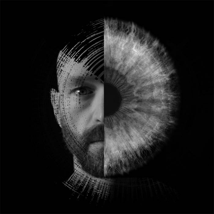 A digital portrait in black and grey of Aaron Collier; half of his face is a close up of an eye