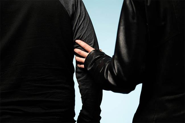 Alex Bulmer's hand holding onto someone's arm