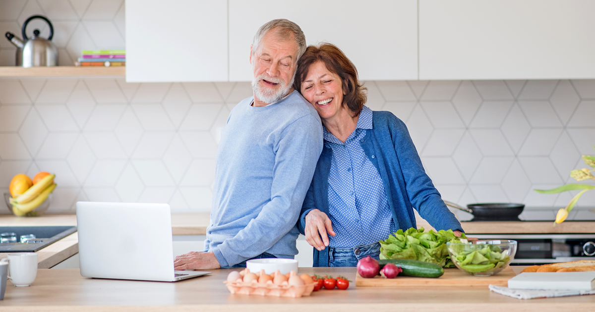 image of a couple preparing a healthy recipe in their kitchen