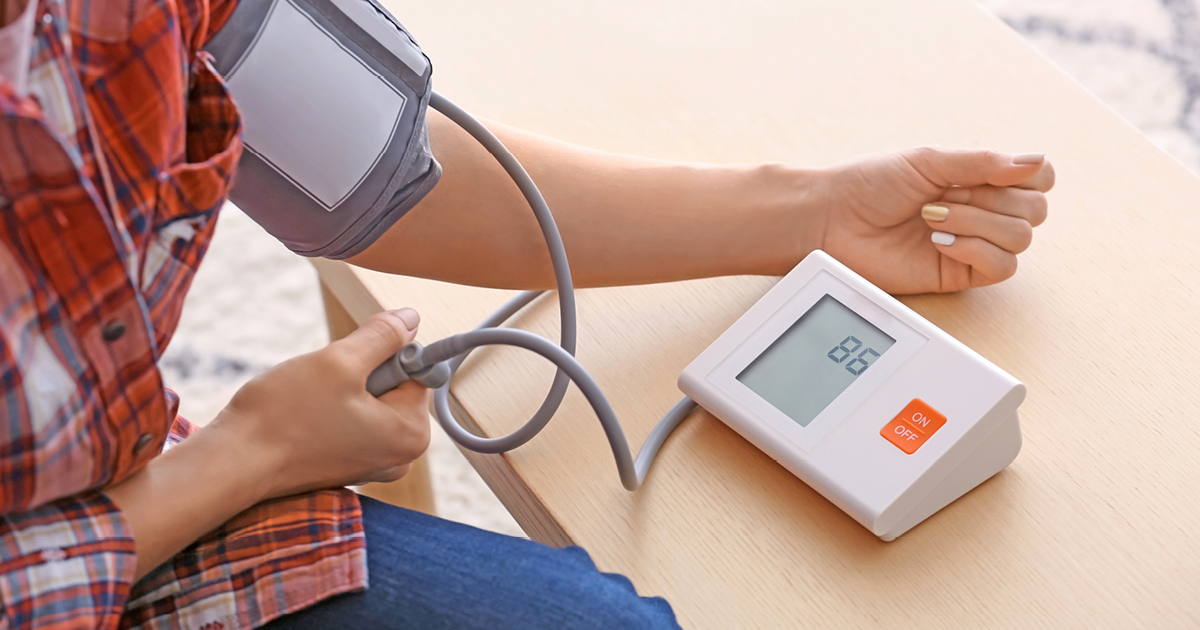 image of a person monitoring their blood pressure in their home