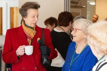 Princess Anne  chats with Danemore residents over coffee