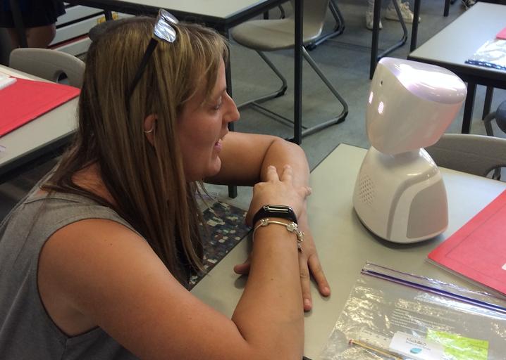 teacher looking at robot