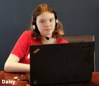 Girl with headphones at computer