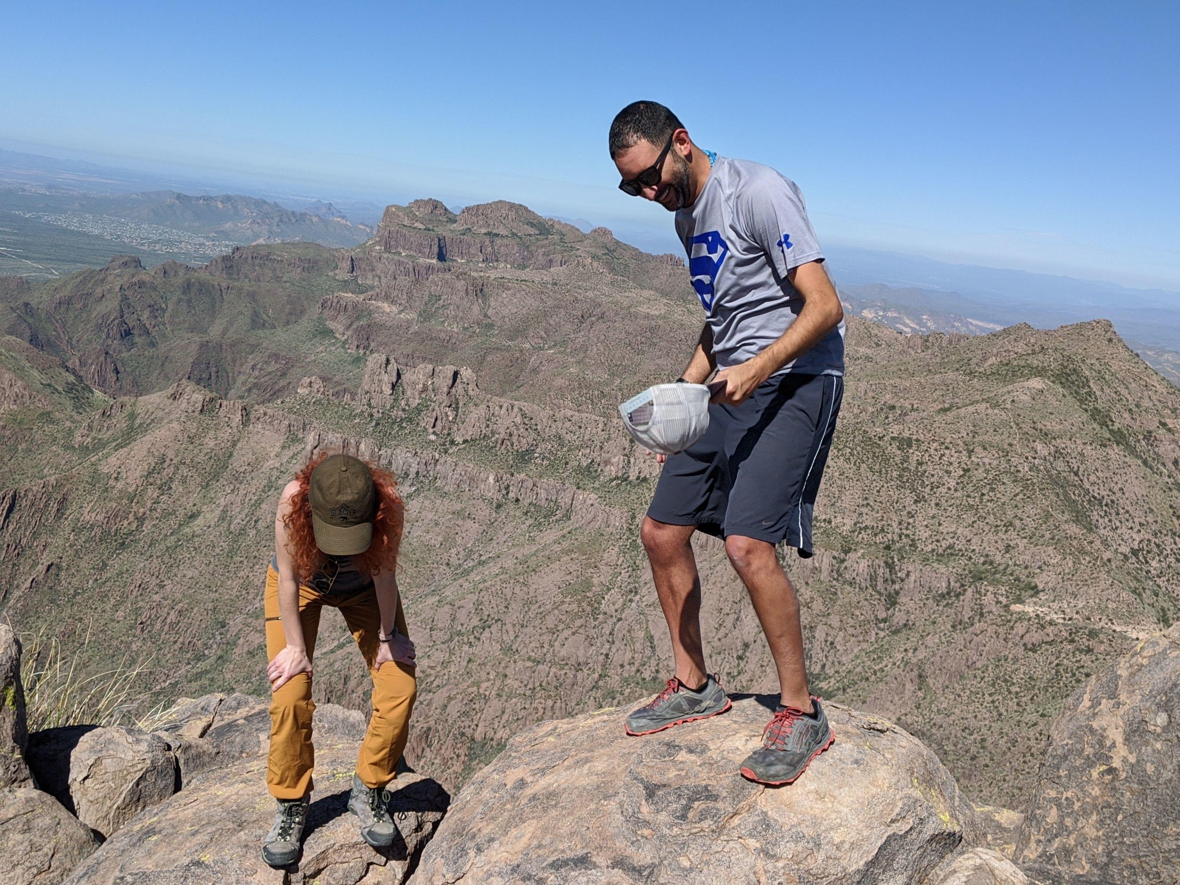 Maggie & Daniel laughing on top of Peak 5057