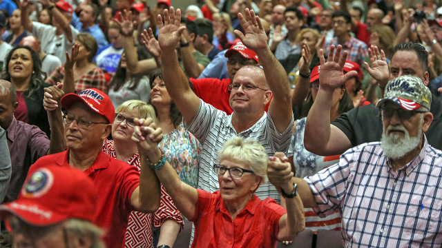 Supporters of President Donald Trump pray at an Evangelicals for Trump rally in Florida. (Adam DelGiudice/Echoes Wire/Barcroft Media via Getty Images)