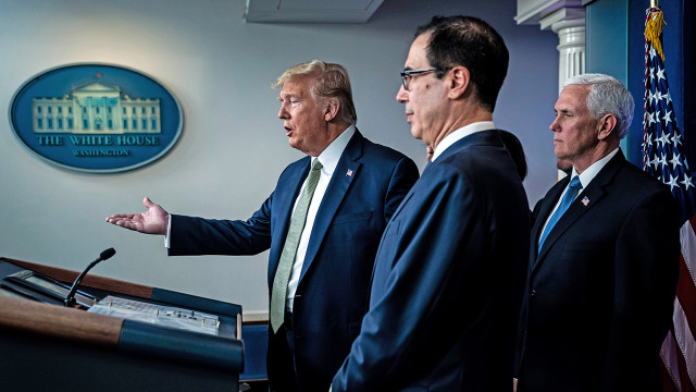 President Donald Trump, Treasury Secretary Steven Mnuchin and Vice President Mike Pence speak at a White House press briefing about U.S. response to the COVID-19 pandemic. (Jabin Botsford/The Washington Post via Getty Images)