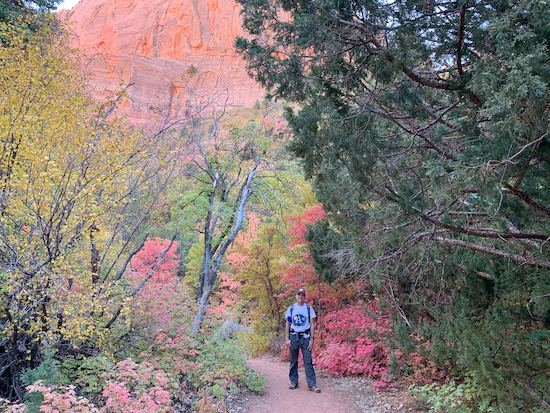 Ron posing amongst fall leaves in Zion