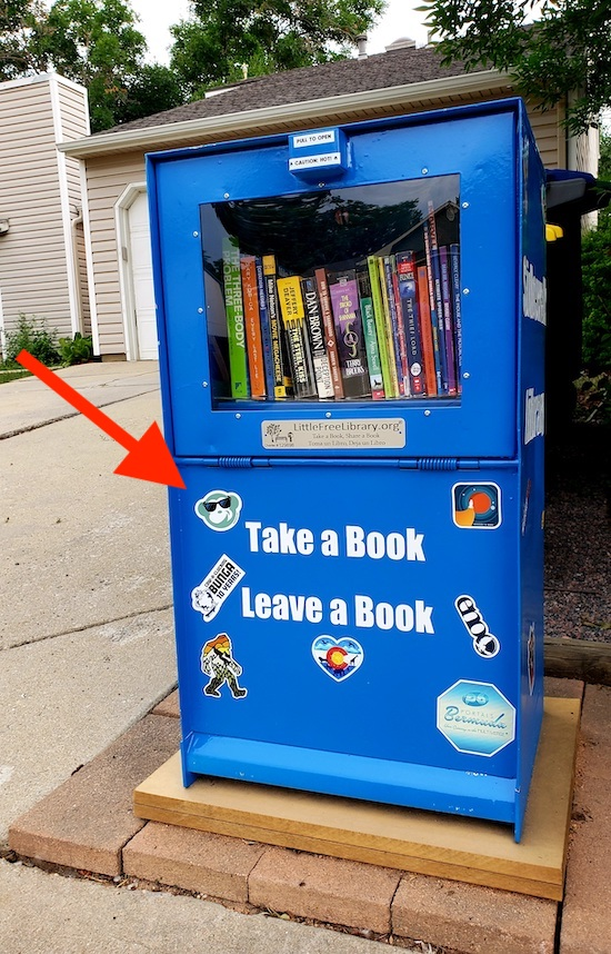 Little Free Library housed in a blue newspaper cabinet
