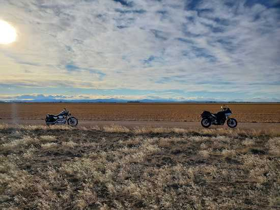 Two motorcycles on a dirt road