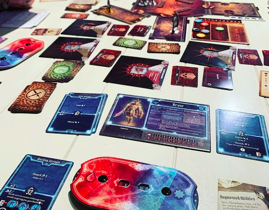 Gloomhaven game cards on table