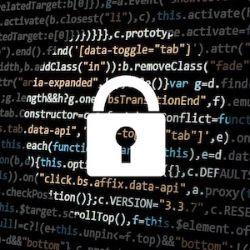 Padlock in front of computer code