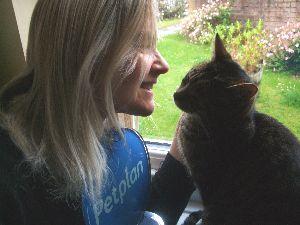 Nicky holds her award whilst stroking her lovely cat, Snugs.