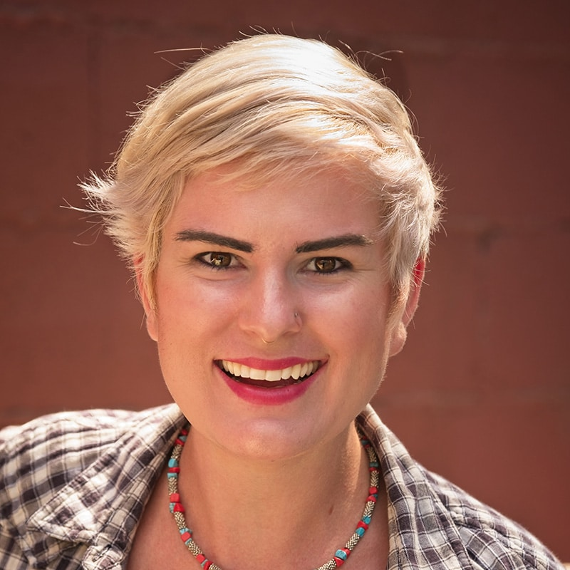 portrait of Kira smiling with short blond hair