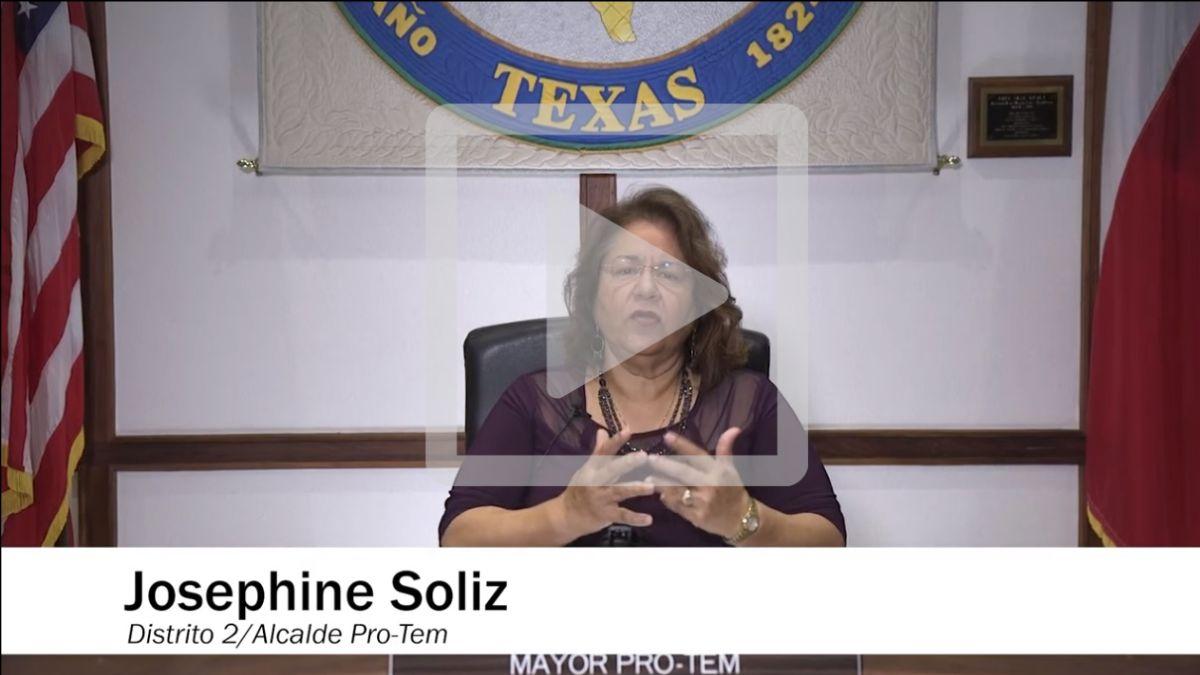 "Woman sits in chair on City Council dais. Text reads ""Josephine Soliz, Distrito 2/Alcalde Pro-Tem"