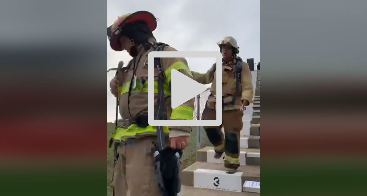 Firefighters climb stairs