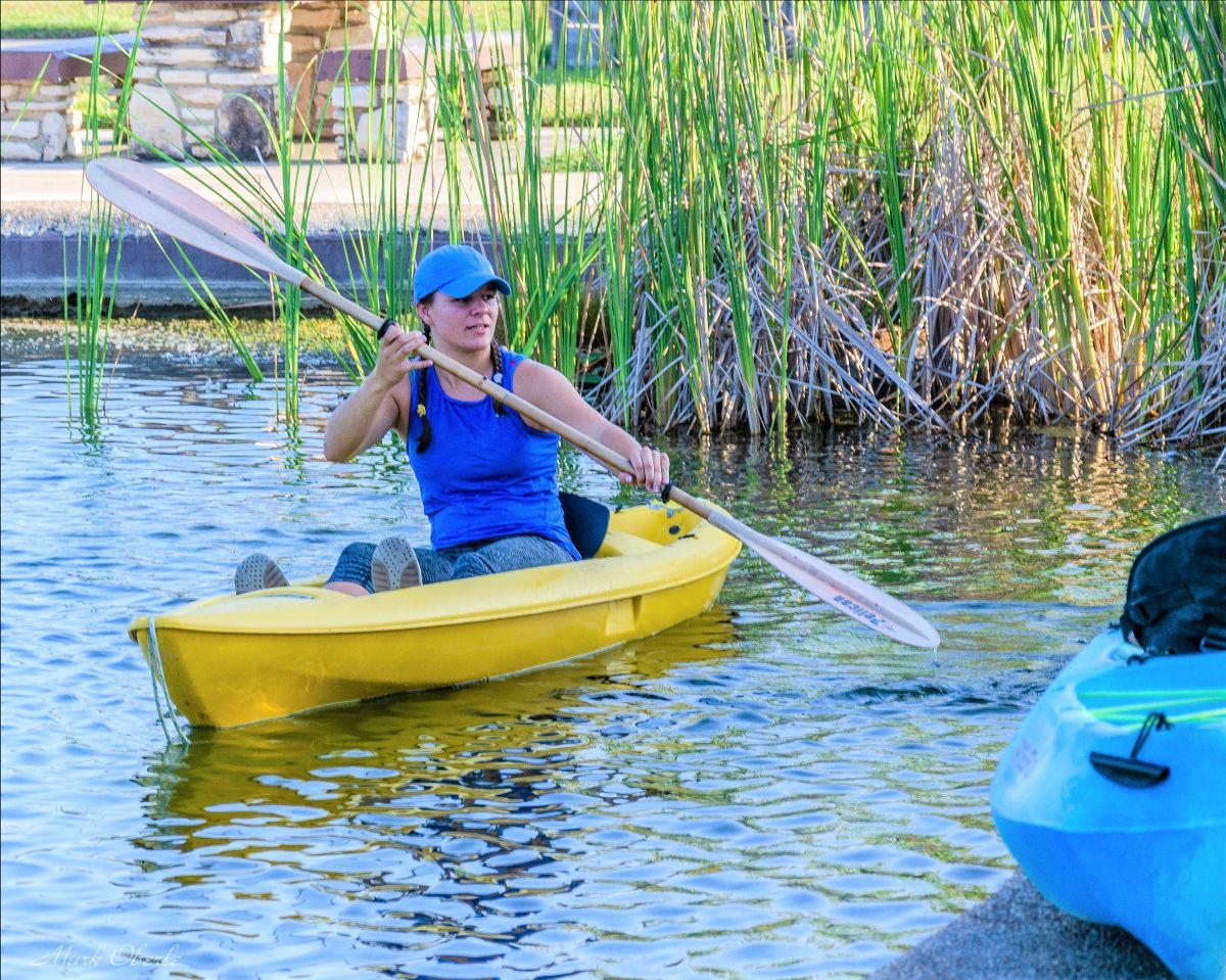 Woman paddling in kayak