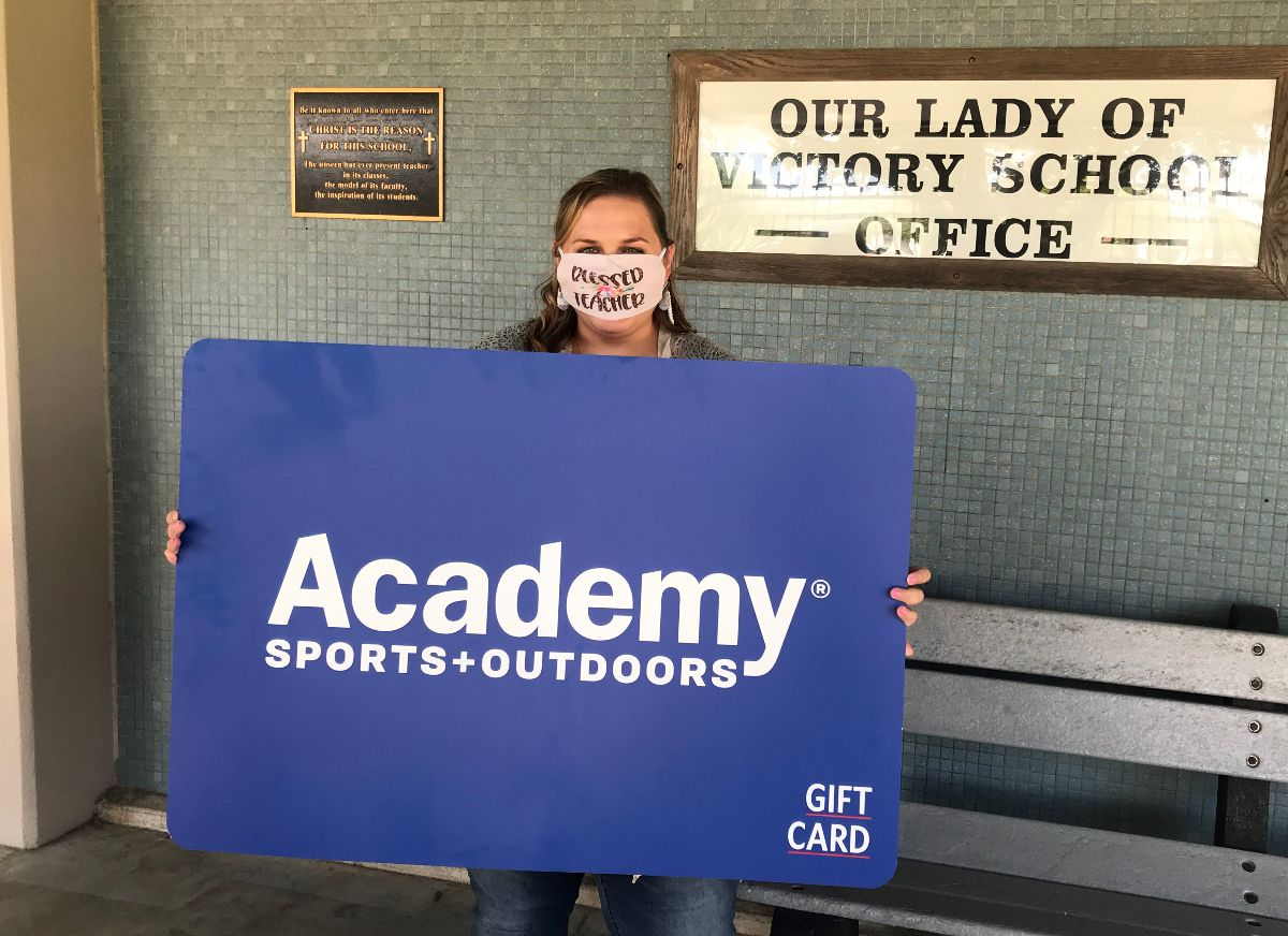 Woman holds giant gift card