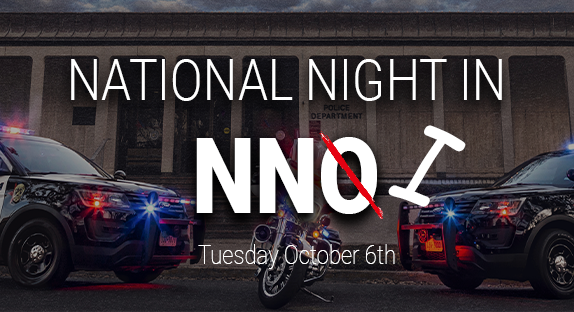 """Police cars in front of City Hall. Text reads """"National Night In: Tuesday, Oct. 6th."""" NNO is crossed out to read NNI."""