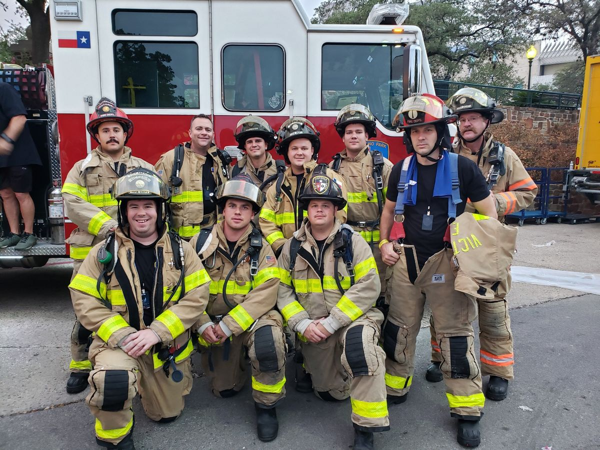 Firefighters in front of fire truck