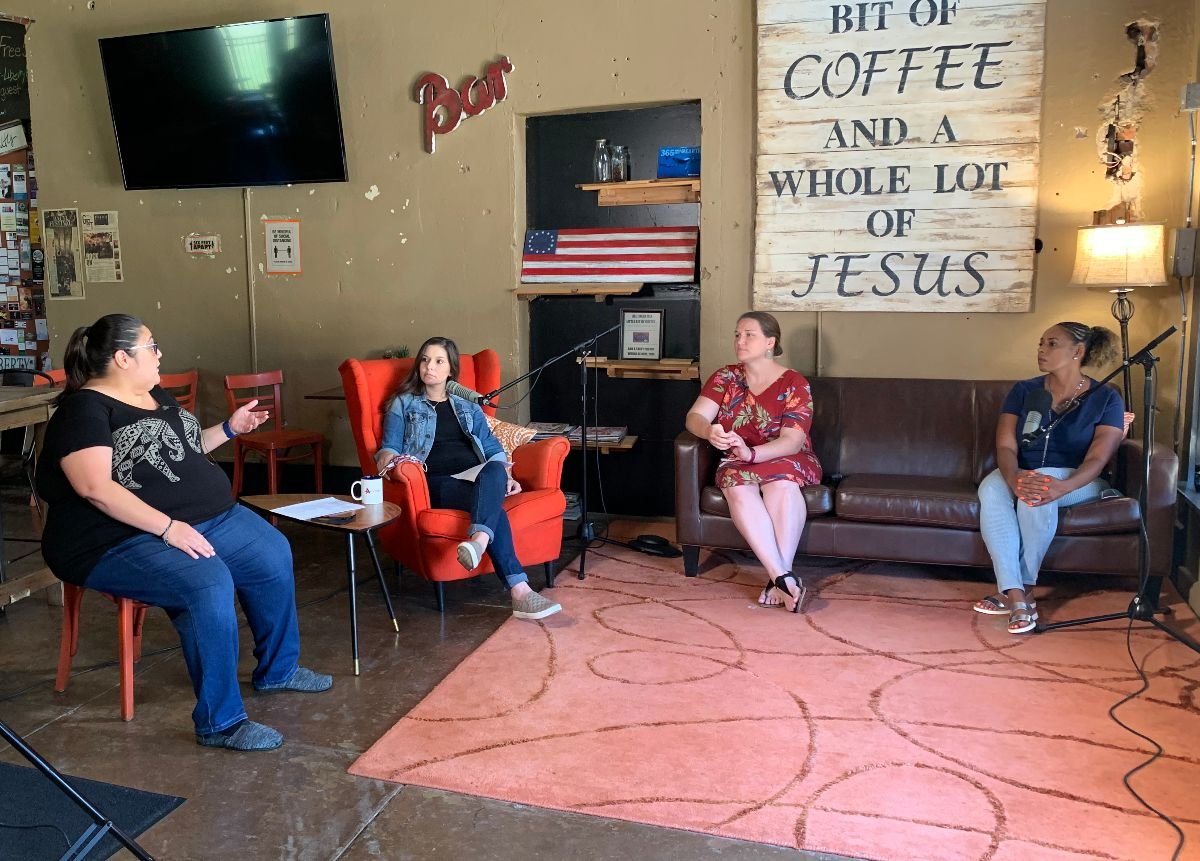Four women sit in coffee shop during interview