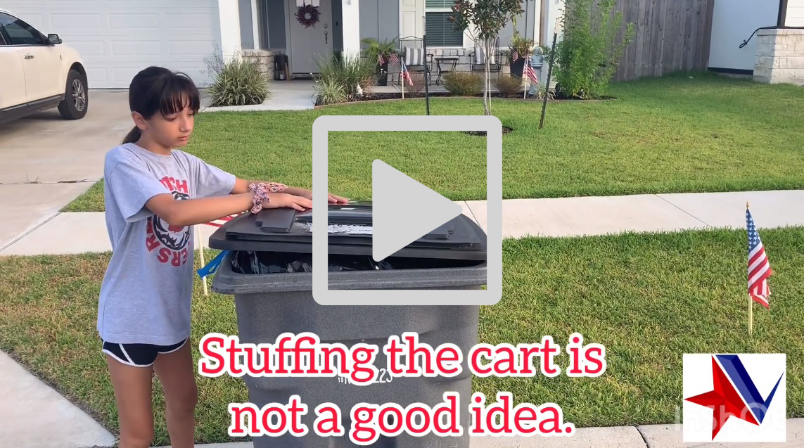 """Girl tries to close lid on overstuffed trash cart. Text reads, """"Stuffing the cart is not a good idea."""""""