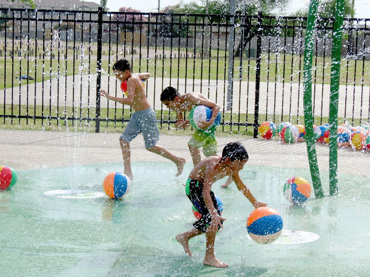 Kids play at splash pad