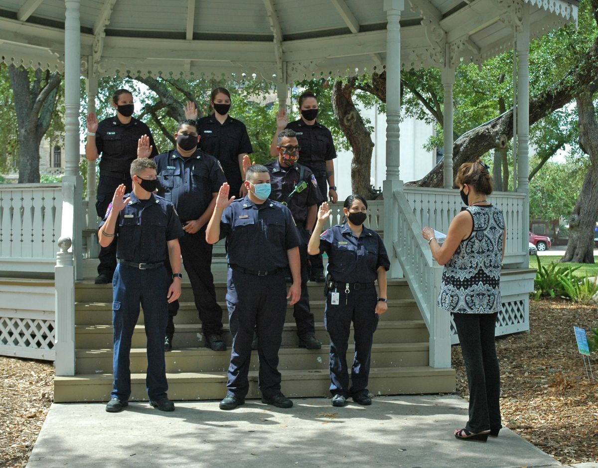 Eight fire department recruits being sworn in at DeLeon Plaza gazebo