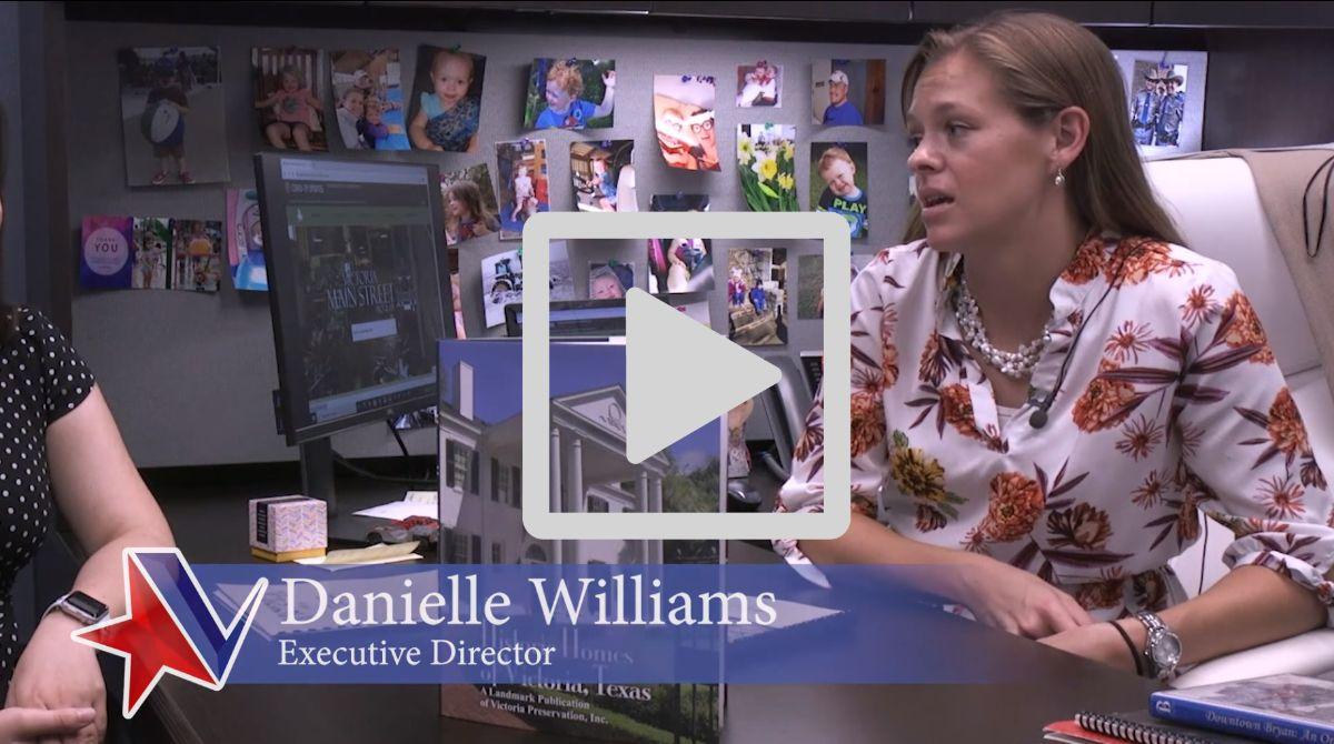 Danielle Williams, executive director, at desk
