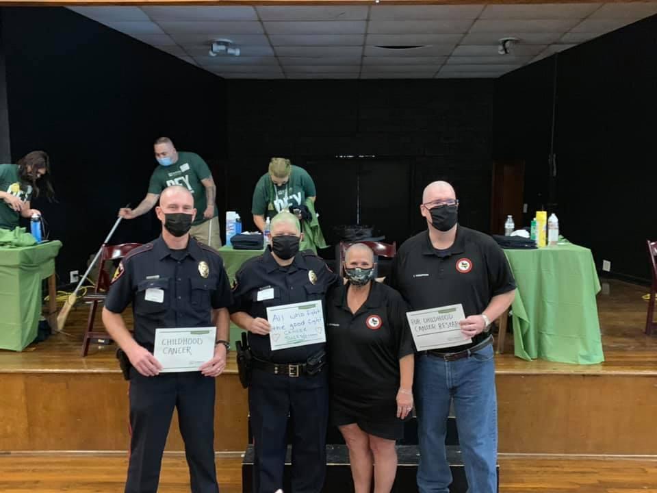 3 first responders wearing masks