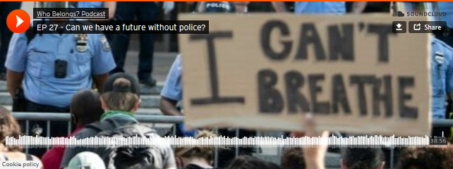 """Image shows protesters (one holding a sign with the words """"i cant breathe"""") confronting police, with barricades separating them."""