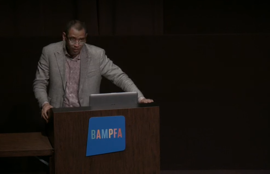 image grab shows rodney leon at a podium