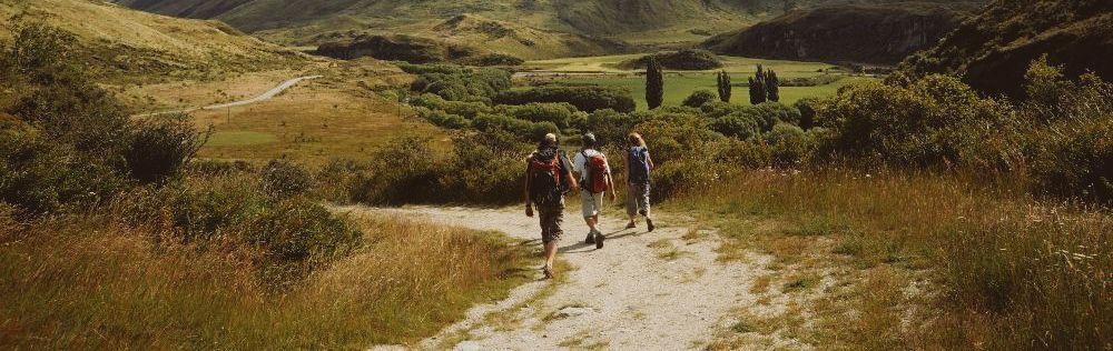 Walking group on path.