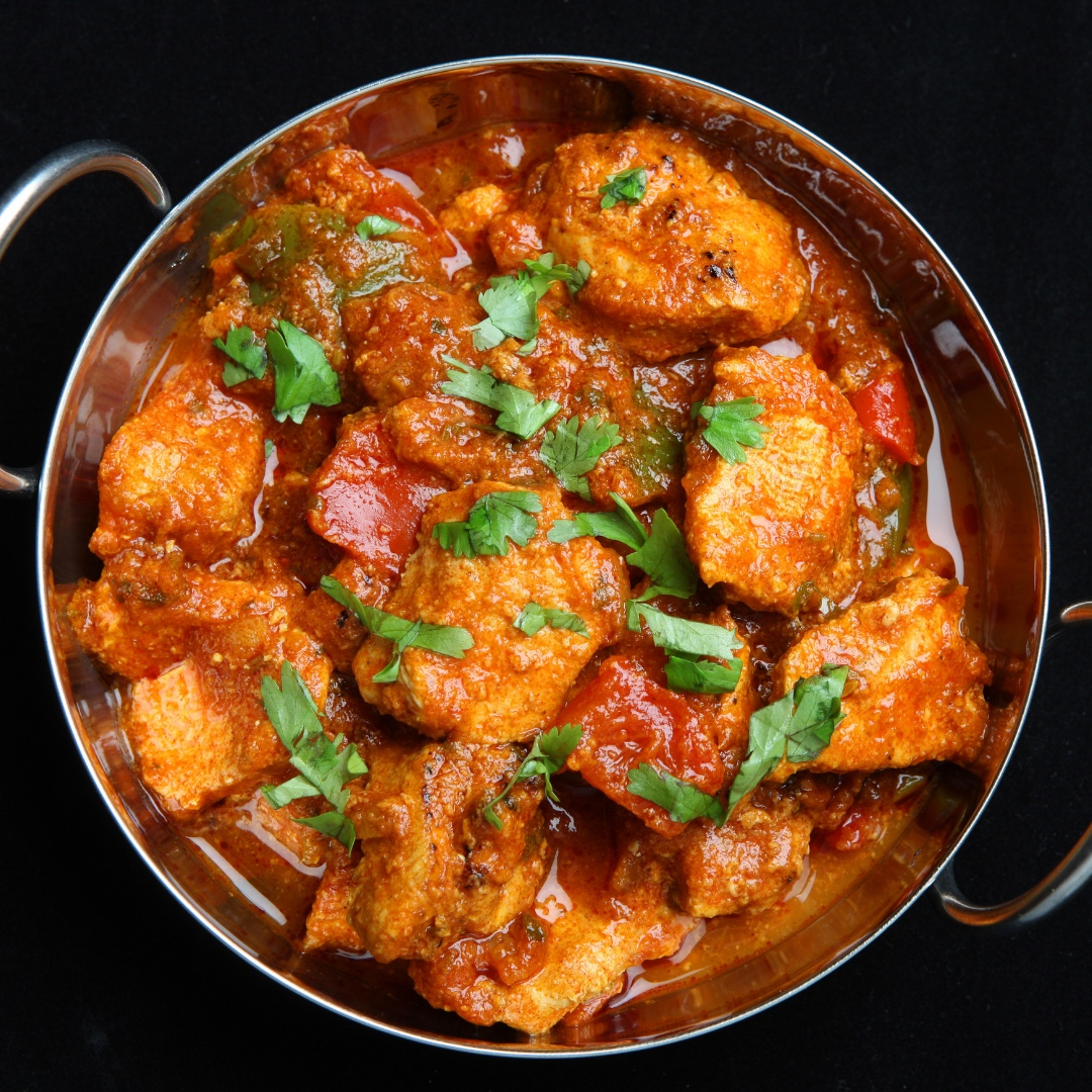 The cuisine of South Africa reflects a melting pot of cultures as reflected in this Cape Malay chicken curry dish. - Wines of South Africa