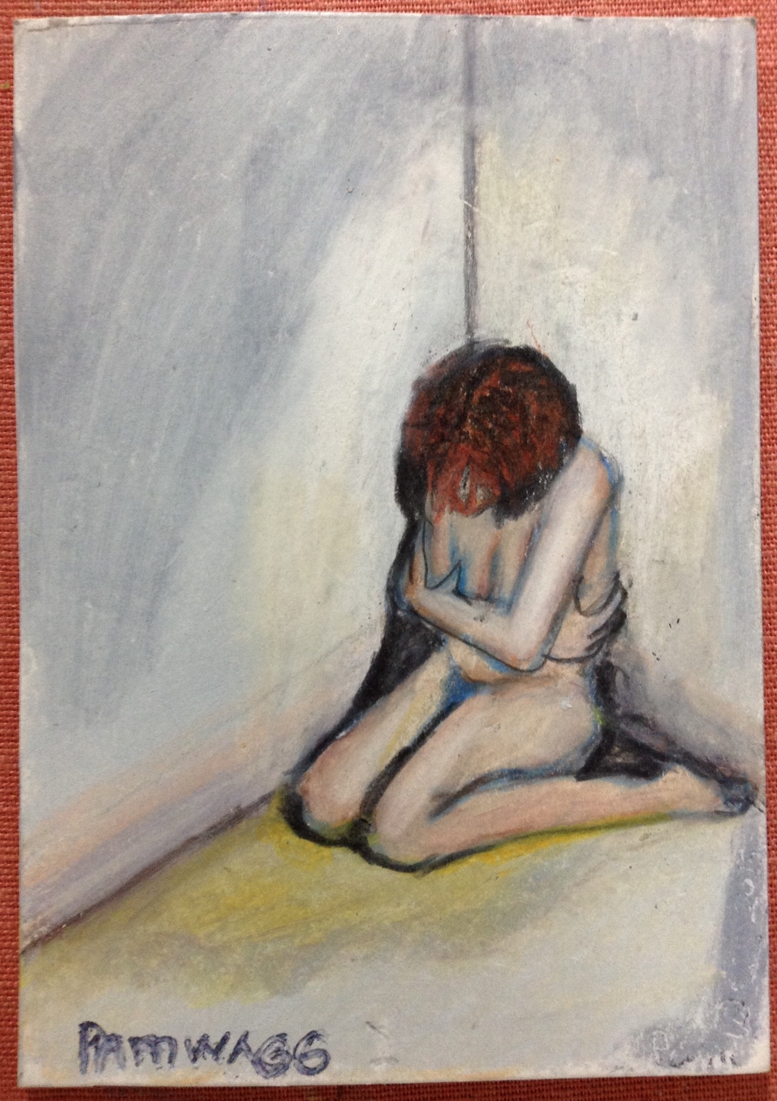 Image of a naked woman huddled in a corner