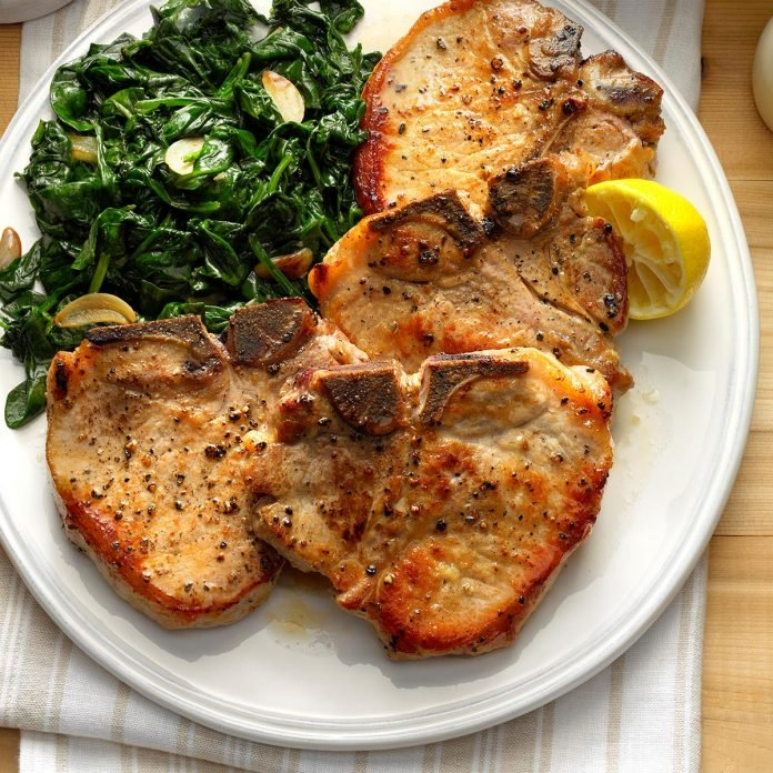Image of sauteed pork chops with garlic spinach