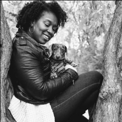 Lauren Newton, jewelry designer and zoologist, with dog