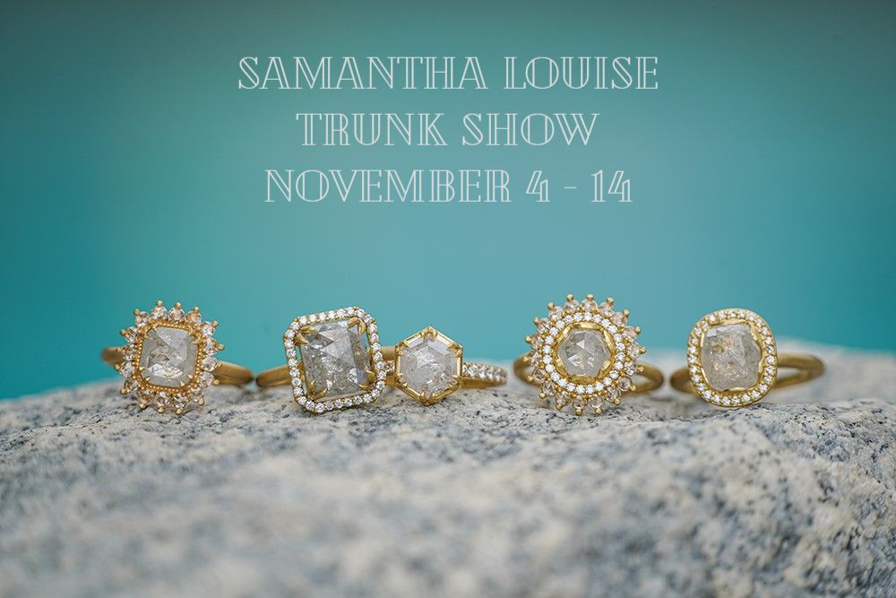 """Samantha Louise rings on concrete with blue background and """"Samantha Louise Trunk Show November 4-14"""" written"""