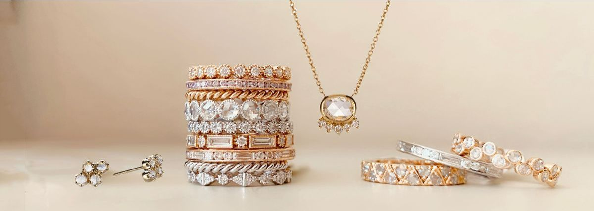 Sethi Couture stack of rings with jewelry surrounding it
