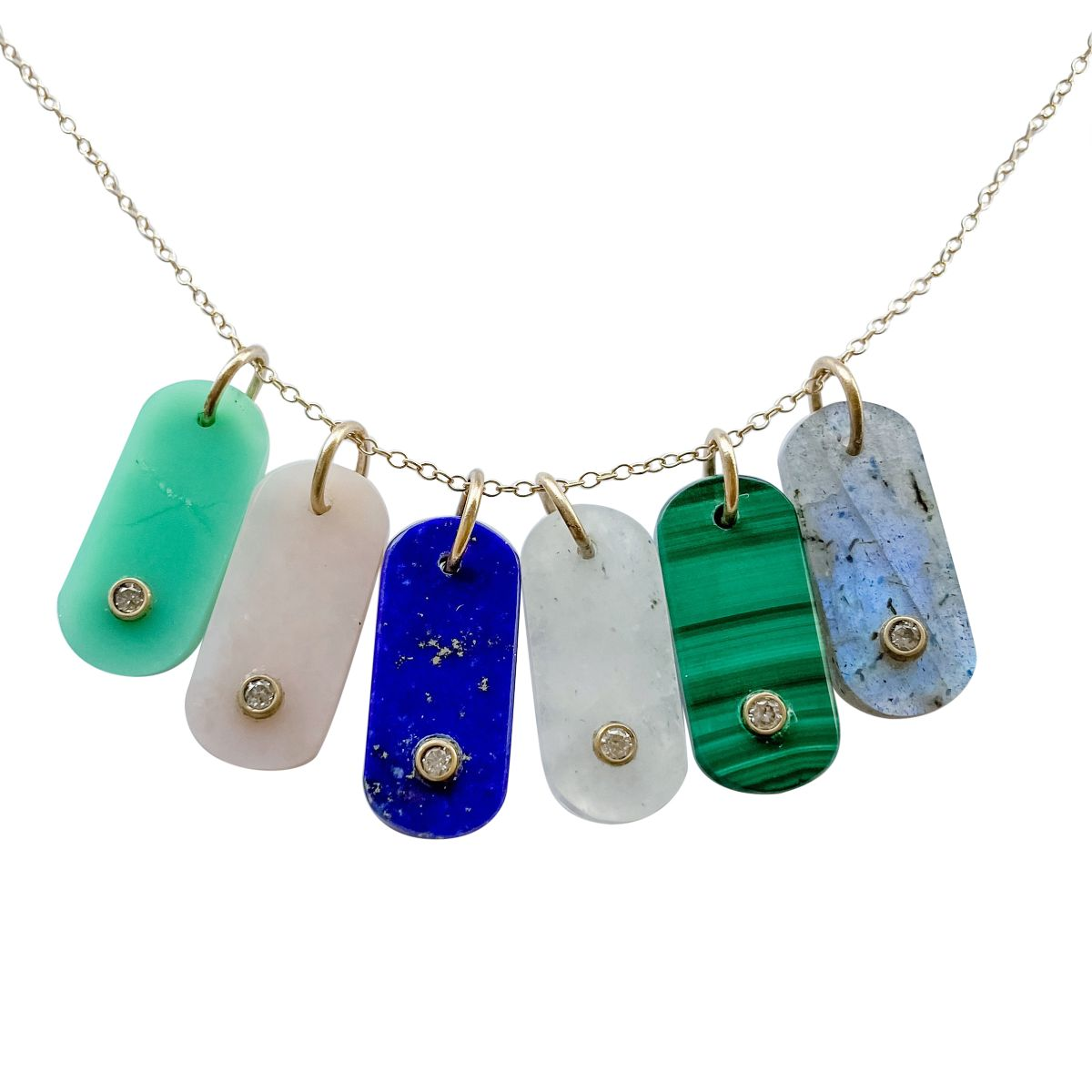 gemstone tabs with diamonds hanging on a chain
