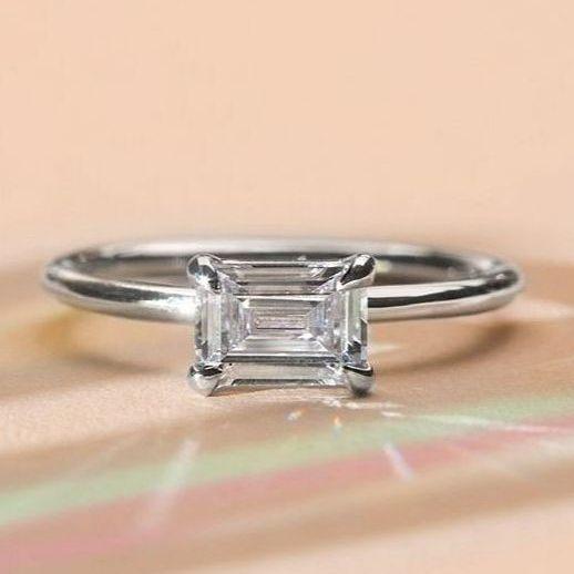 emerald cut diamond ring in white gold