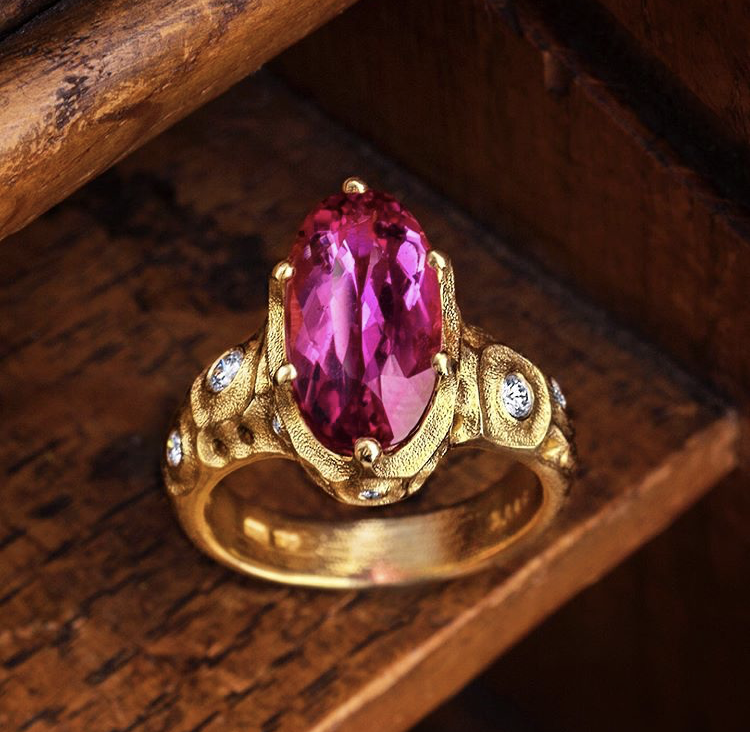 Alex Sepkus 18ky ring with pink tourmaline oval stone on wood