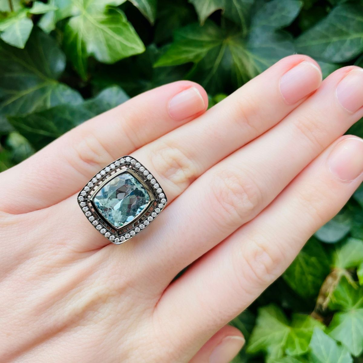 Link takes you to blackened white gold aquamarine and diamond ring.