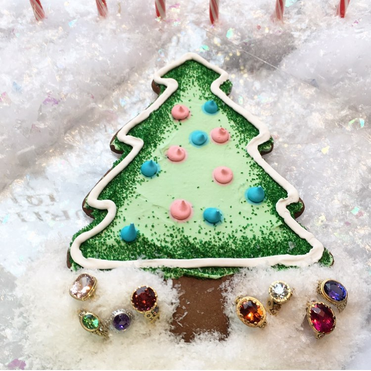 Christmas Tree cookie in snow with colorful rings underneath