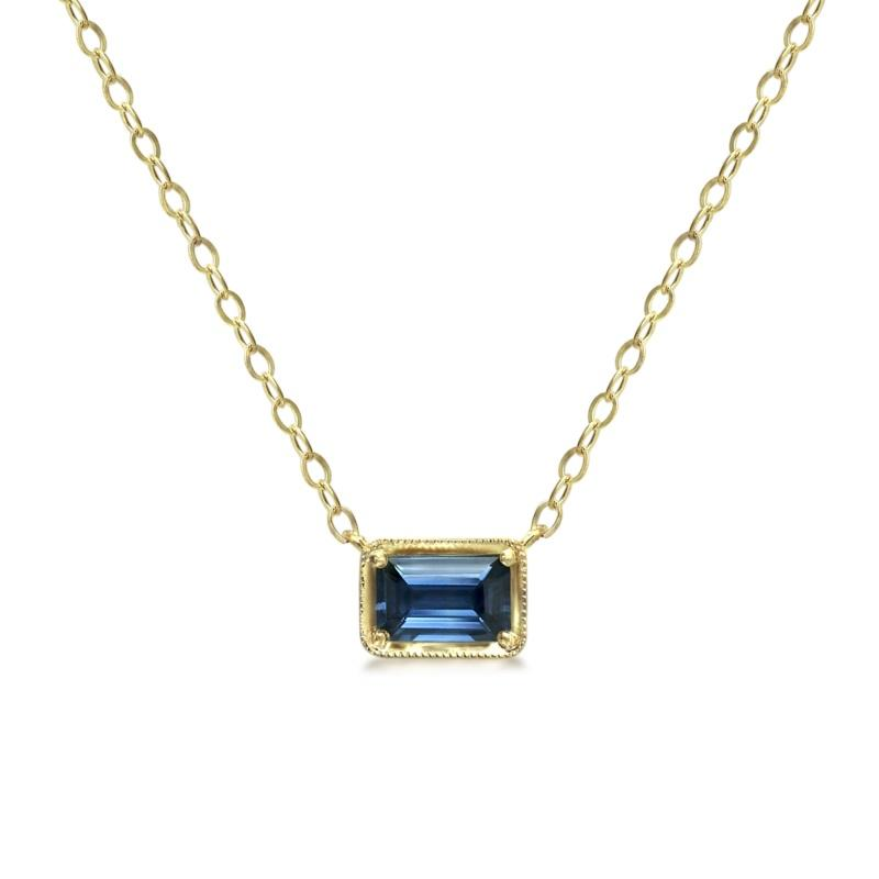 Blue and gold pendant with chain on white background