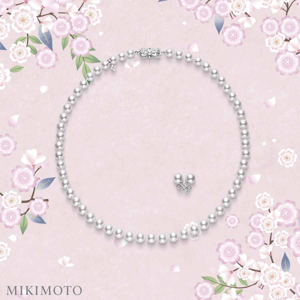 White pearl necklace on pink background with flowers