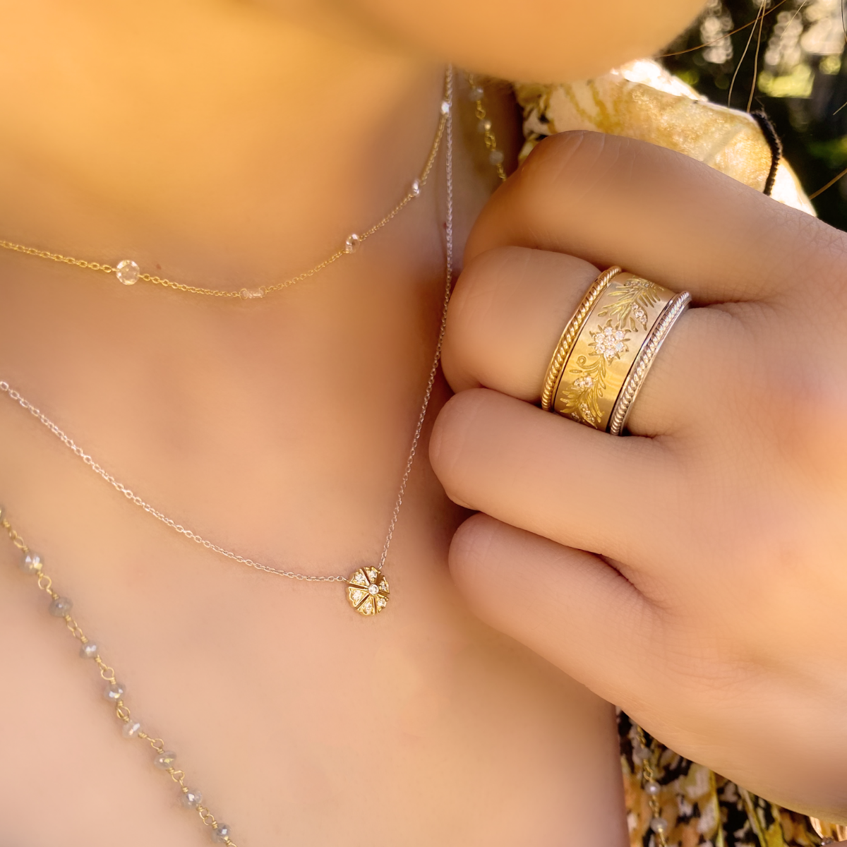 Woman's neck and hand with jewelry on it