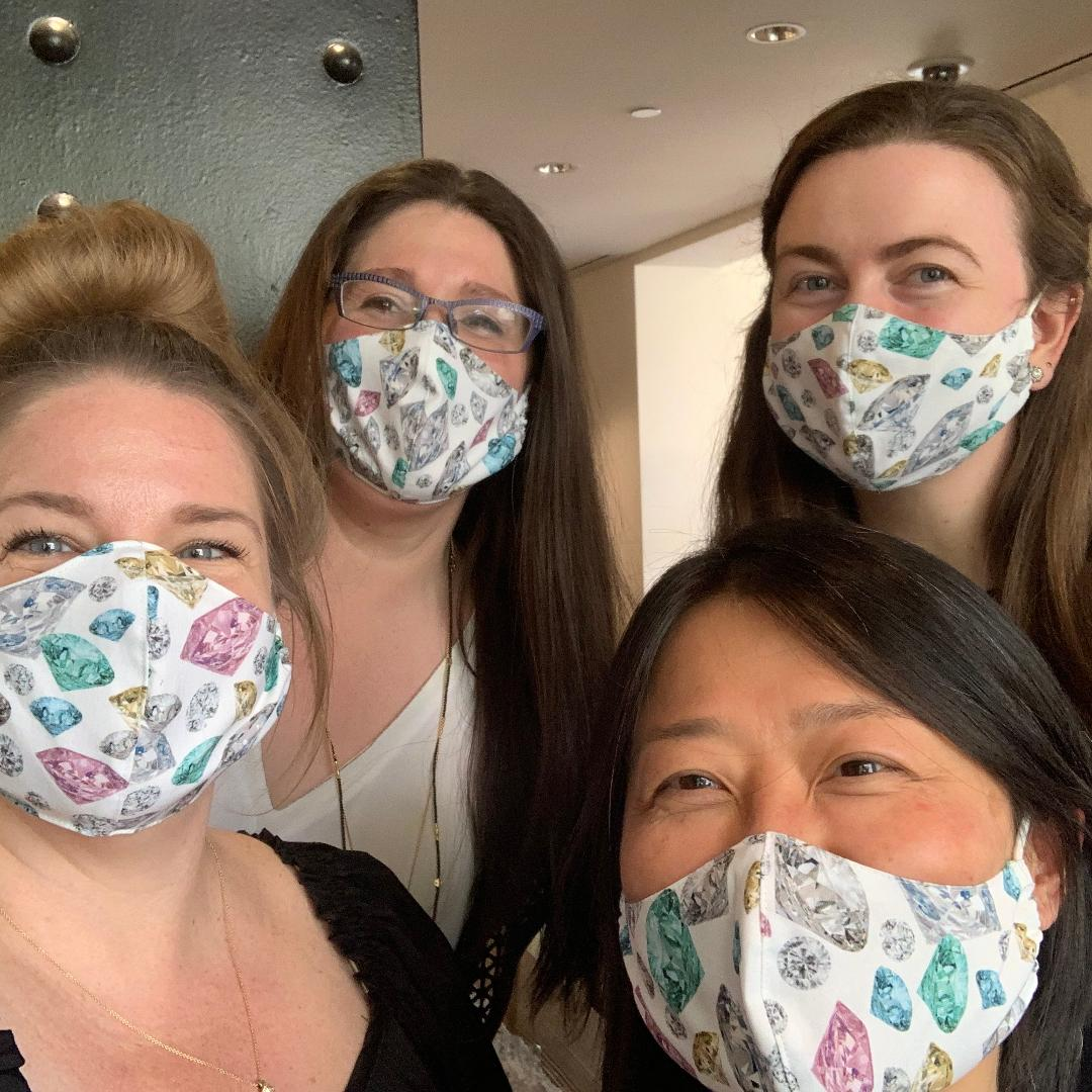 4 women with diamond patterned face masks on