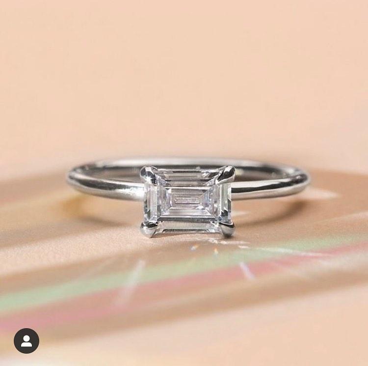 ILA 18k white gold engagement ring emerald cut set east west.